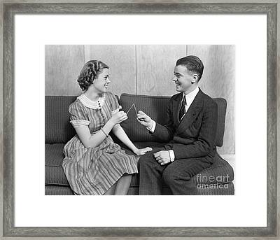 Teen Couple Pulling Wishbone, C.1930s Framed Print by H. Armstrong Roberts/ClassicStock