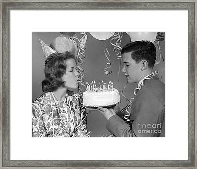 Teen Girl Blowing Out Birthday Candles Framed Print by H. Armstrong Roberts/ClassicStock