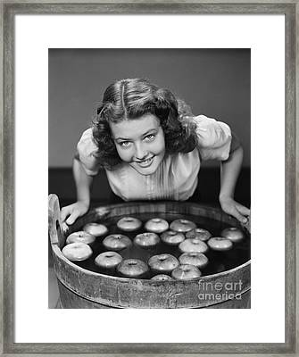 Teen Girl Bobbing For Apples, C.1940s Framed Print by H. Armstrong Roberts/ClassicStock