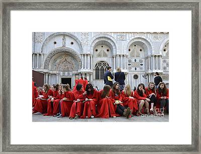 Teenager Girls From A Uk Choral Group Waiting Outside St Mark Basilica In Venice Framed Print by Sami Sarkis