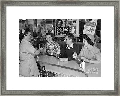 Teens At A Diner, C.1950s Framed Print by H. Armstrong Roberts/ClassicStock