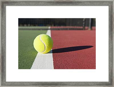 Tennis Ball Sitting On Court Framed Print by Thom Gourley/Flatbread Images, LLC