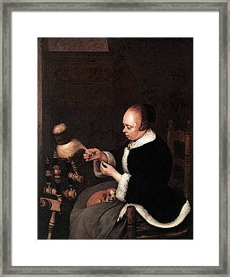 Terborch Gerard A Woman Spinning Framed Print by Gerard ter Borch