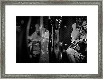 Testing Guitars Framed Print