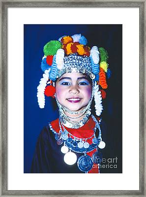 Framed Print featuring the photograph Thai Girl Traditionally Dressed by Heiko Koehrer-Wagner