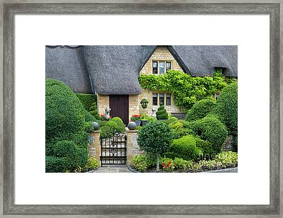 Framed Print featuring the photograph Thatch Roof Cottage Home by Brian Jannsen