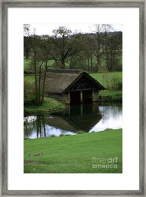Thatched Boat House Framed Print by Robert  Torkomian