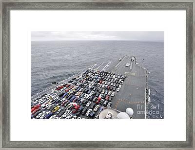 The Aircraft Carrier Uss Ronald Reagan Transports Sailors Vehicles. Framed Print