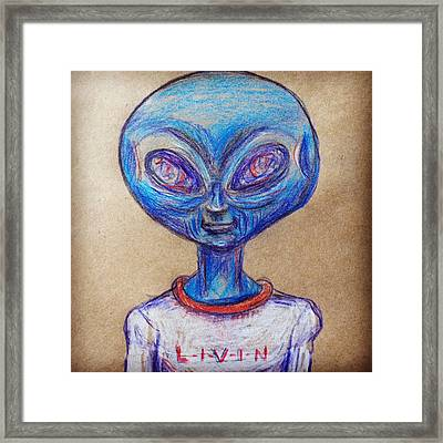 The Alien Is L-i-v-i-n Framed Print