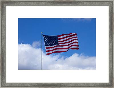 The America Flag Waves On Framed Print