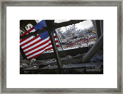 The American Flag Is Prominent Amongst Framed Print by Stocktrek Images