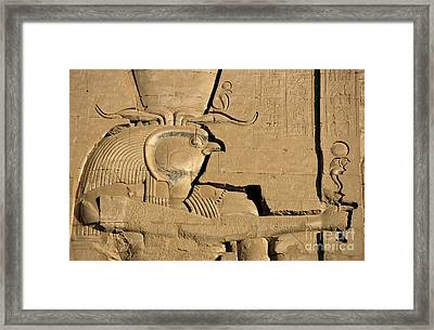 The Ancient Egyptian God Horus Sculpted On The Wall Of The First Pylon At The Temple Of Edfu Framed Print by Sami Sarkis