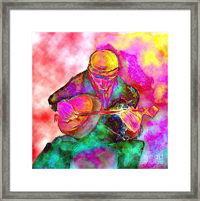The Banjo Player Framed Print