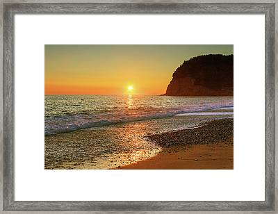 the beach and the Mediterranean sea in Montenegro in the summer at sunset Framed Print