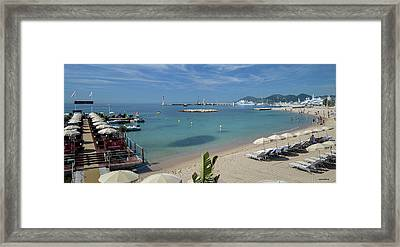 Framed Print featuring the photograph The Beach At Cannes by Allen Sheffield