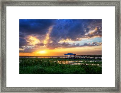 The Boathouse At Sunset Framed Print by Debra and Dave Vanderlaan