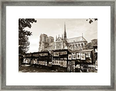 The Bouquinistes And Notre-dame Cathedral Framed Print