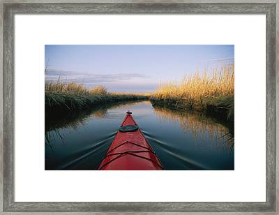 The Bow Of A Kayak Points The Way Framed Print