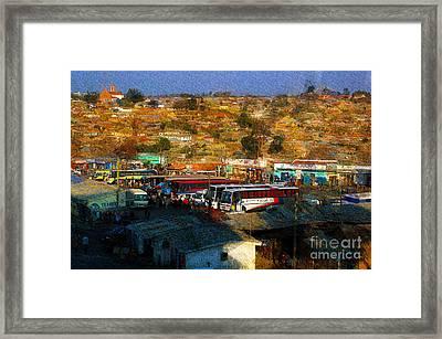 The Bus Terminal-iringa Framed Print by Morris Keyonzo