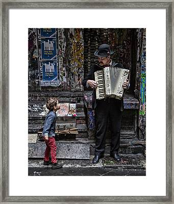 The Busker And The Boy Framed Print
