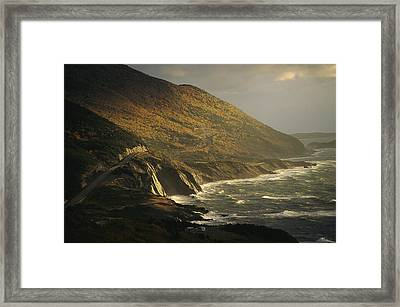 The Cabot Trail Winds Its Way Framed Print by Raymond Gehman
