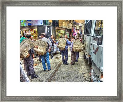 The Carriers  Framed Print by Michael Garyet