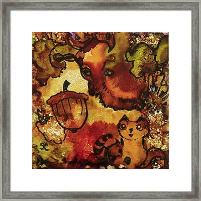 The Cat And The Acorn Framed Print
