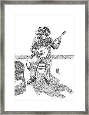 The Cold Banjo Player Framed Print