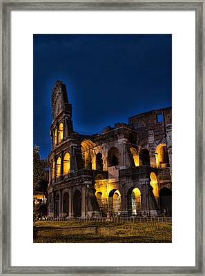 The Coleseum In Rome At Night Framed Print