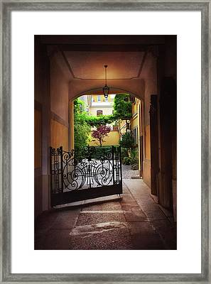 The Courtyard Gate Framed Print by Carol Japp