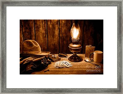 The Cowboy Nightstand - Sepia Framed Print by Olivier Le Queinec