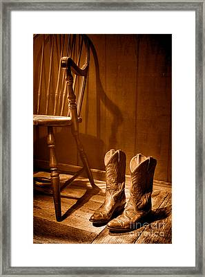The Cowgirl Boots And The Old Chair - Sepia Framed Print by Olivier Le Queinec