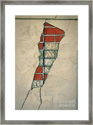 The Cracked Wall Framed Print