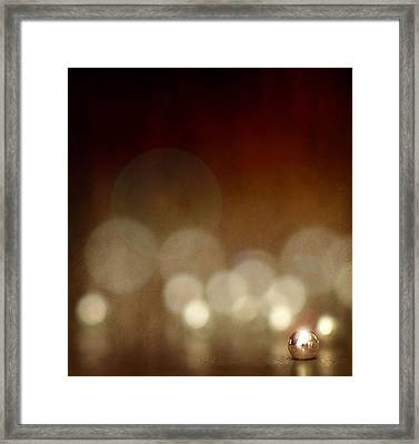 The Crimp Bead Framed Print