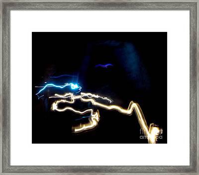 The Dark Cave Framed Print