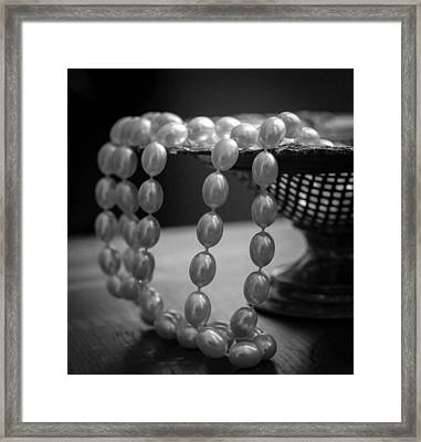 The Drama Of Pearls Framed Print