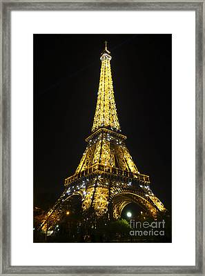 The Eiffel Tower At Night Illuminated, Paris, France. Framed Print