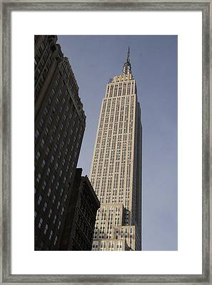 The Empire State Building Towers Framed Print by Taylor S. Kennedy