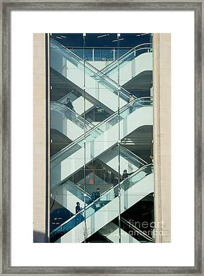 The Escalators Framed Print by Colin Rayner