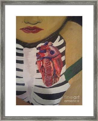 The Exposed Heart Of An Angel Framed Print