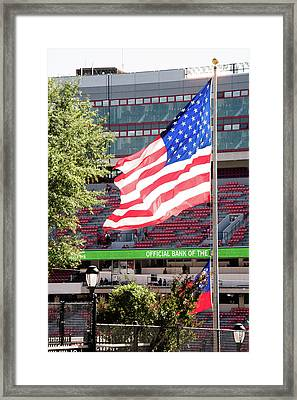 Framed Print featuring the photograph The Flag Flying High Over Sanford Stadium by Parker Cunningham