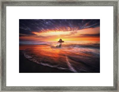 The Flaming Rock Framed Print