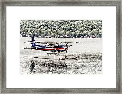 The Float Framed Print