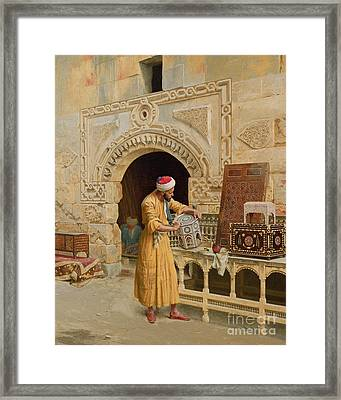 The Furniture Maker Framed Print by Ludwig Deutsch