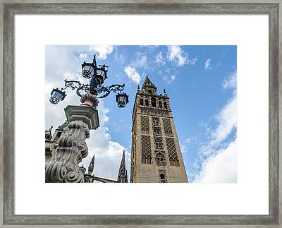 The Giralda And The Blue Sky Framed Print by Andrea Mazzocchetti