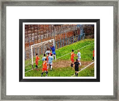 The Goalkeeper Saves A Goal Framed Print by John Vito Figorito