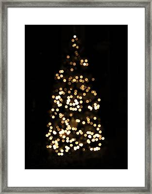 The Golden Glow Of A Christmas Tree Framed Print by Rona Black