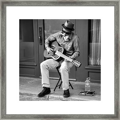 The Guitar Man Framed Print