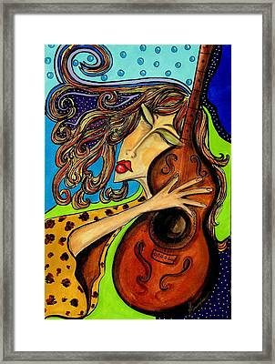 The Guitarist Framed Print by Yvonne Feavearyear