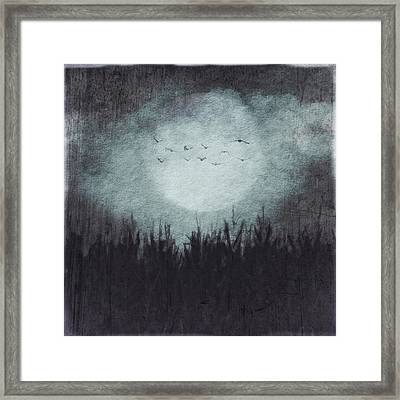 The Heavy Moon Framed Print
